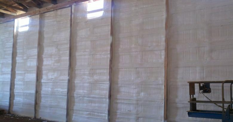 Spray foam insulation in calving barn